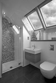 Gray And White Bathroom With Skylight In Shower