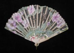 Fan  Date ca. 1900-1905  Description Folding fan. Silk gauze leaf with applied painted paper flowers and butterflies; the painted flowers are pink with green leaves, and resemble the Rose of Sharon (Hybiscus syriacus).