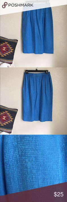 Vintage cerulean silk skirt Vintage cerulean silk skirt with pleating at hips. 100% silk, lined. Clasp closure at back. In great condition. Size 10. Skirts