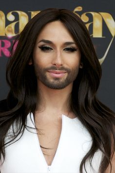 Pin for Later: Ariana Grande Beats the Heat With a Perfect Pony Conchita Wurst As she received the Madrid Pride Award, Austrian singer Conchita wore her hair in loose, flowing waves (and her contour game was on point). Two Different Colored Eyes, French Maid Dress, Transgender People, Face Claims, Her Hair, Celebrity Style, Drag Queens, Actresses, Beauty Secrets