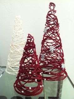 Yarn Christmas Tree DIY...I'd probably leave them nice & simple...use silver & golds possibly!
