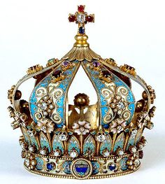 Crown: Identified with power, glory, and consecration. Originating with wreaths, crowns draw on the celestial symbolism of the circle-representing perfection and the ring-representing continuity.