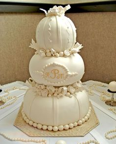 Pumpkin Pearl Drops - We did this cake today for a bride who had a pumpkin theme....she loved this design!  It was a ton of work, but probably one of the most enjoyable cakes to put together.  The top is a large ball pan,  and the two bottoms are 12 and 16 inch stacked 3 layers high and carved round.  The baubles are fondant; roses and ribbons gumpaste.  I used hidden pillars to stack.