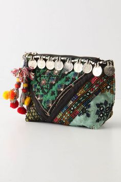 Bohemian clutch: Malabata Pouch, made in India. Love the tassels, pom-poms, coins, and fabric scraps this eclectic purse is made of. #fashion #boho #bag