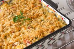 Great meal for busy moms. Kid favorite mac and cheese, with ham and peas made on a large scale. Make up one batch and freeze one or two dishes for meals later. Add salad and bread and you have a complete meal. Great for freezing to save time in the kitchen.