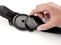 Lens Cap strap Holder - Never loose a lens cap again.    I really need something like this. I am always misplacing my lens cap :/