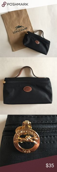 """HP  Longchamp Cosmetic Bag NWOT - Put all you essential cosmetics in this small and cute bag.  Perfect for traveling.  Makes a great gift.  Measurements:  Height 4.5""""/Length - 8""""/Depth 2.5""""/Drop - 2.25"""" Longchamp Makeup Brushes & Tools"""