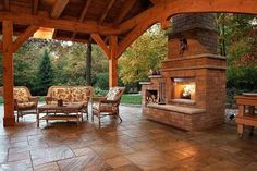Lovely, open porch with large fireplace.