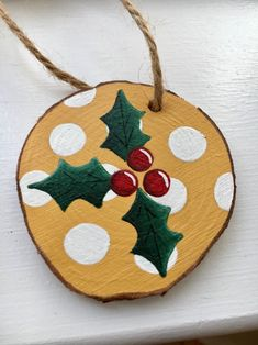 Beautifully Hand painted wood slice ornament of Christmas holly Painted Christmas Ornaments, Christmas Ornament Crafts, Christmas Art, Handmade Christmas, Holiday Crafts, Holly Christmas, Christmas Mantles, Hand Painted Ornaments, Wooden Ornaments