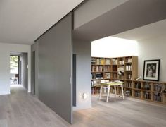 Modern Interior Design At Eco Sustainable House With White Oak Flooring And Grey Sliding Door As Room Divider Hide The Home Library Sliding Room Dividers, Sliding Wall, Sliding Door Panels, Wall Dividers, Room Divider Doors, Paris Home, Nachhaltiges Design, Door Design, Moving Walls