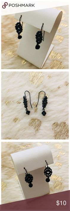 Vintage Black Beaded Earrings One earring is slightly bent, but not majorly. Each earring has one small black bead hanging from it. Jewelry Earrings