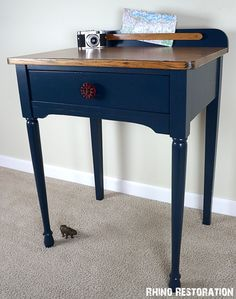 Lovely Farmhouse Chic Side Table - Desk.  Painted Navy Blue with cute red faucet handle drawer pull.  Refinished wood top.  Lacquered Finish.  Rhino Restoration Quality!