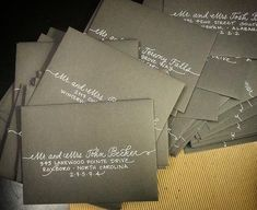 """My """"mixed script"""" with extra flourishes. White ink on matte, grey envelopes. {Calligraphy by Carrie}"""