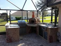outdoor kitchen with wood fired oven