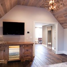 angled ceiling w/ wood planks & hardwood floors of the same color