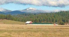 Snow-capped Mount Spokane rises above farmlands northeast of the bustling city of Spokane.