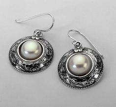 Sterling Silver Dangle earrings with Cultured Pearls Elegant dangling earrings for women - round motif. Israeli typical jewelry. If, for any reason, you are not