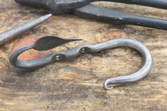 These all steel hooks are hand forged using traditional blacksmithing techniques. Great for a key rack or even a coat hanger. The bend for this item is to the right. Combine our hooks bent to the left for a whimsical look!