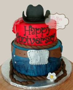 Cowboy/Western anniversary cake, hand painted fondant jeans, hand painted fondant bandanna, hat made from chocolate cake. Fondant detail.