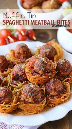 Muffin Tin Spaghetti Meatball Bites -Iconic Spaghetti and Meatballs served in the perfect bite size appetizer for any party, gathering or dinner dish. These meatballs are baked in a muffin tin with spaghetti noodle pasta and tomato sauce then topped with cheese.  #MyRecipeMagic #dinner