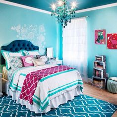 What a beautiful break from all that pink while still staying feminine! super cute girls bedroom // love the navy and the turquoise!