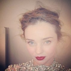 Bridal beauty: Miranda Kerr channels 1920s with a plaited updo and berry lips. www.handbag.com