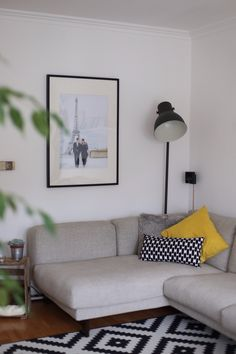 Living room | Couch | Ikea | Paris | yellow and black and white | Hektar standing lamp | carpet | pillow Love | vintage side table by vanessaesau