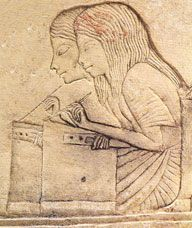 Egyptian scribes at work writing. I think the scribe in the foreground is female.