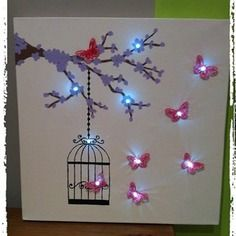 Toile lumineuse papillon et cage à oiseaux