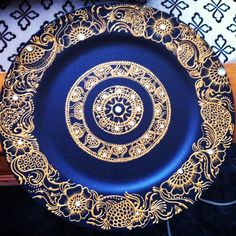 Gold henna plate design.