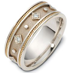 14K two-tone, 8.5 mm wide, diamond ring. 0.15 ct diamond weight in size 6.0. The center of the ring is a coarse and heavy sandblast finish. There is one hand made rope on each side of the band. The outer edges are polished. Different finishes may be selected or specified. #diamonweddingband