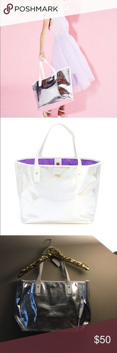 """Ban.do everything tote bag - silver A fabulous carry-all, this Everything Tote from ban.do is super shiny and fun in metallic silver with white trim. The body of the bag is made of leatherette and the contrasting piping and handles are a textured leatherette. At 19"""" x 5.625"""", you'll be able to use this classic tote to carry anything and everything you need. It goes from day to night with ease as a purse, a reusable shopper, a carry-on or an overnight bag.  19"""" x 5.625"""" Metallic leatherette…"""