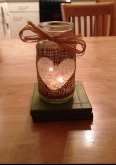 Rustic jam jar, I made lots of different ones using lace, twine, raffia and burlap. Some had candles in and the others had flowers in.