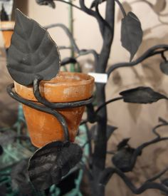 "Salterini wrought iron tree plant stand holds 5"" pots in its branches. From #NYBG  #garden #antiques fair."