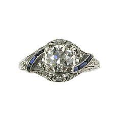 Art Deco Platinum and Diamond Openwork Ring with Calibré-Cut Sapphires