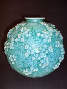 C. 1924 RENE R LALIQUE CASED OPALESCENT DRUIDE VASE WITH TEAL GREEN PATINA