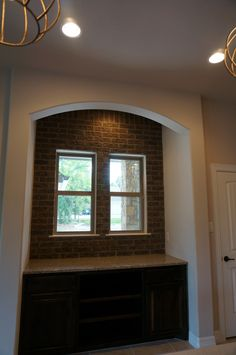 Extra counter area in kitchen with brick wall backsplash