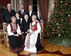 Back row (L-R) King Harald, Crown Prince Haakon and Marius Borg Hoiby, front (L-R) Queen Sonja, Princess Ingrid Alexandra, Prince Sverre Magnus and Crown Princess Mette-Marit pose during a Christmas photo session at the Royal Palace in Oslo, on 17.12.2014.