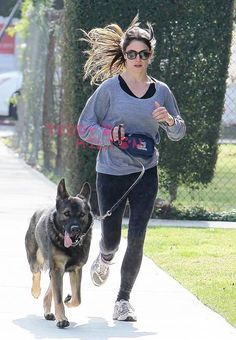 Nikki Reed Sprints To Cuteness With Dog Enzo!