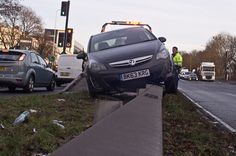 110-365 Silly Place To Park - Photo a Day Project - Or how did he turn it round the wrong way before mounting the crash barrier?www.flickr.com/photos/johngarghan #PhotoADay #project365 #365project #virtualartgallery #CarCrash #UnconventionalParking #CarParking