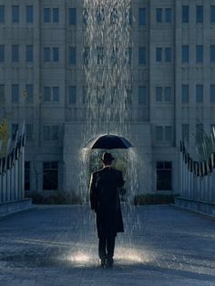 Joseph Hancock created this image of a man walking beneath a localized shower, protected by his umbrella. Some pictures of rain such as this one are perhaps a testament to our ability to weather temporary struggles.