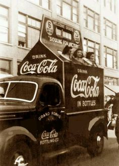 Vintage Coca-Cola - Girls in 6-pack carton for Coca-Cola and truck in parade