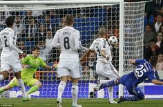 Klaas-Jan Huntelaar beats Pepe to the ball and fires home Schalke's fourth goal against Real Madrid at the Bernabeu