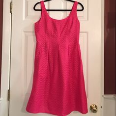 "Nine West pink dress Nine West pink fitted dress with an overlay of ""lace"" look size 10 in excellent condition. This looks like it is new. This has a zipper back with a scoop in the front and back. 100% polyester. 38"" length 17"" chest and 15"" waist Nine West Dresses Midi"