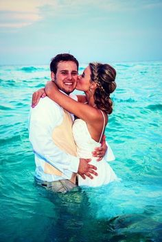 I love this!!! but wouldn't wanna get my dress wet on the big day..so he'd just roll up his pants and cradle me in his arms while standing in the beautiful ocean :) :)