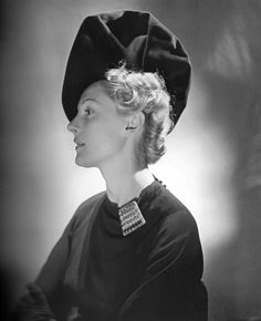 her incredible millinery work.