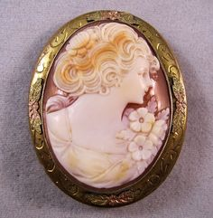 """Antique Hand Carved Shell Cameo Pendant/Brooch Of A Lady With Flowers Mounted In 10k Gold With 10k Solid Gold Tri-Gold Flower Leaf Accents Top, Bottom And Each Side - Signed On The Clasp """"ALLC""""     C.1910's-1920's"""