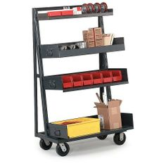 """VALLEY CRAFT Vari-Tuff A-Frame Trucks - Gray by Vari-Tuff. $413.00. VALLEY CRAFT Vari-Tuff A-Frame Trucks can be easily configured to aid in lean manufacturing or point-of-use handling or assembly. Eases storage, sorting, and distribution of parts and supplies. All-welded steel units are available in either a single- or double-sided configuration. Single-sided trucks hold (7) 6""""H trays; double-sided trucks hold (14) 3""""H trays per side. All trucks roll on 5"""" phenolic ..."""