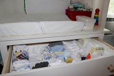 Changing table organization idea for the #nursery, wonder where I can find drawer dividers...