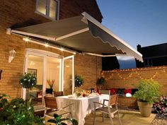 Beautiful Retractable Awnings can even be mounted to brick walls!